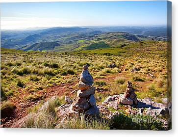 Stone Cairns Canvas Print by Carlos Caetano