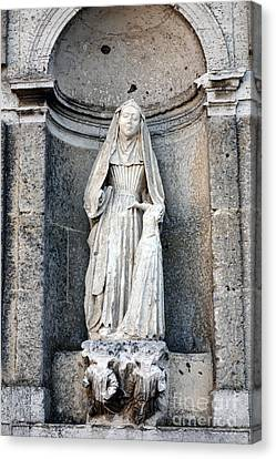 Stone Nun Canvas Print by Olivier Le Queinec