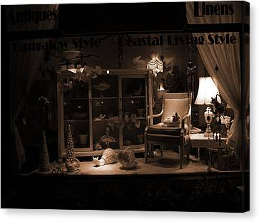 Store Window At Night Canvas Print by Phil Penne