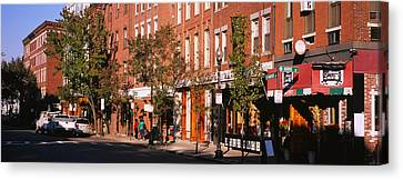 Stores Along A Street, North End Canvas Print by Panoramic Images