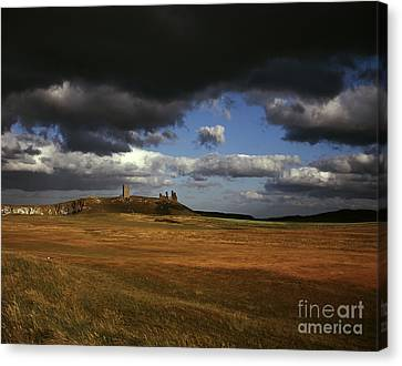 Storm Clouds And Dunstanburgh Castle  At Embleton Bay Embleton Northumberland England Canvas Print by Michael Walters