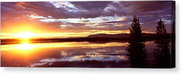 Storm Clouds Over A Lake At Sunrise Canvas Print by Panoramic Images