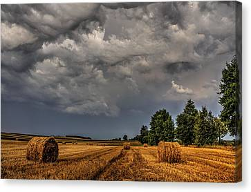 Storm Clouds Over Harvested Field In Poland 2 Canvas Print by Julis Simo
