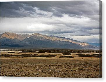 Storm Clouds Over Snowy Peaks Canvas Print by Stuart Litoff