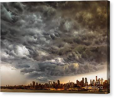 Storm Coulds Over Nyc Canvas Print by Jerry Fornarotto