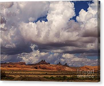 Storm Over Monument Valley Canvas Print by Janice Rae Pariza