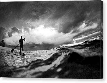 Storm Paddler Canvas Print by Sean Davey