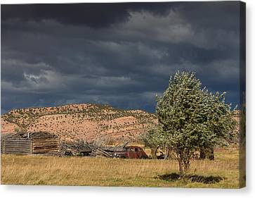 Log Cabin Art Canvas Print - Storm Whipping Desert Homestead by Kathleen Bishop