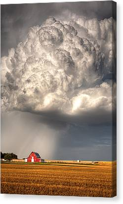 Stormy Homestead Barn Canvas Print by Thomas Zimmerman