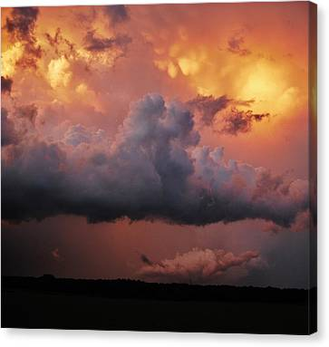 Canvas Print featuring the photograph Stormy Sunset by Ed Sweeney