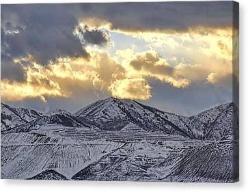 Stormy Sunset Over Snow Capped Mountains Canvas Print by Tracie Kaska