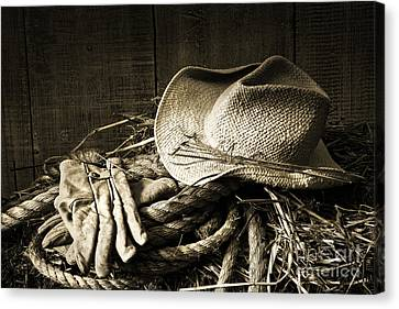 Straw Hat With Gloves On A Bale Of Hay Canvas Print by Sandra Cunningham