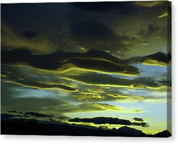 Streaming Clouds  Canvas Print by Jeff Swan