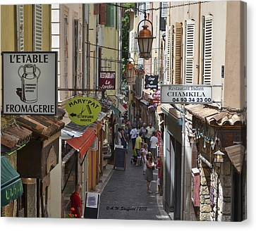 Canvas Print featuring the photograph Street Scene In Antibes by Allen Sheffield