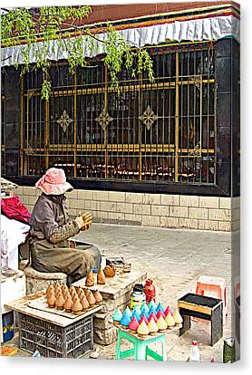 Street Shopkeeper In Lhasa-tibet Canvas Print by Ruth Hager