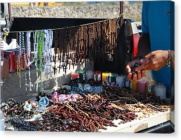 Street Vendor Selling Rosaries Canvas Print by Amy Cicconi