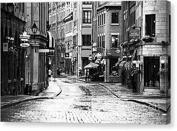 Streets Of Montreal Canvas Print by John Rizzuto