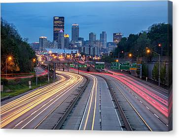 Streaming Into Town Canvas Print by Jennifer Grover