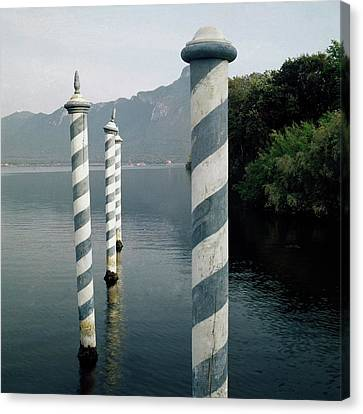 Striped Posts In The Grand Canal Canvas Print by Leombruno-Bodi