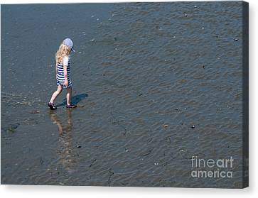 Strolling On The Beach Canvas Print by Malu Couttolenc