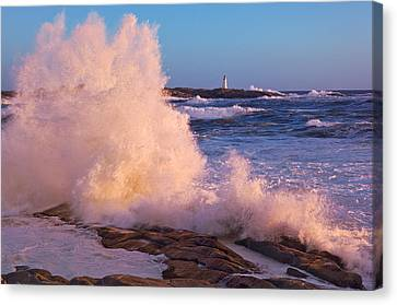 Strong Winds Blow Waves Onto Rocks Canvas Print by Thomas Kitchin & Victoria Hurst