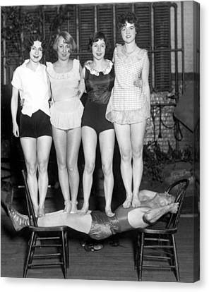 Troupe Canvas Print - Strongman Holds Up Actresses by Underwood Archives