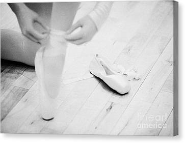 Student Putting On Pointe Shoes At A Ballet School In The Uk Canvas Print