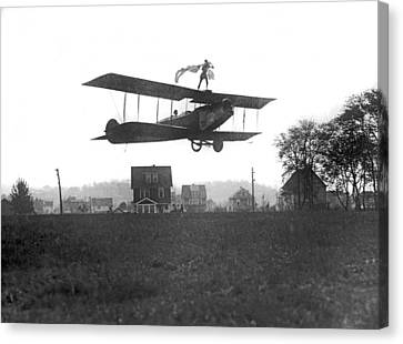 Stunts Atop A Biplane Canvas Print by Underwood Archives