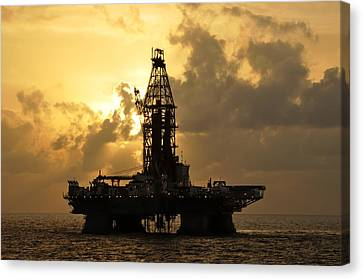 Canvas Print featuring the photograph Sun Behind Oil Rig With Clouds by Bradford Martin