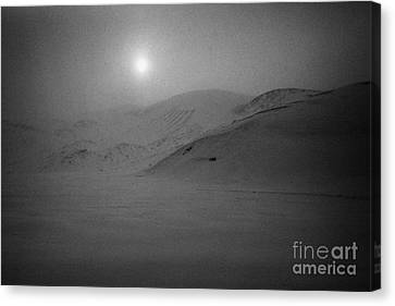 sun breaking through white out snowstorm whalers bay deception island Antarctica Canvas Print