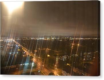 Sun Over City Lights Canvas Print by Naomi Berhane