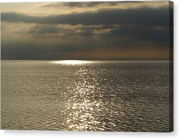 Sun Rays And Reflections In The Sea Canvas Print by Gynt