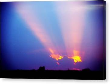 Sun Rays At Sunset Canvas Print by Eric Benjamin