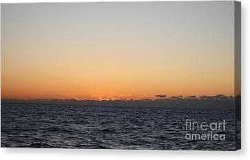 Sun Rising Above Clouds And Horizon Canvas Print by John Telfer