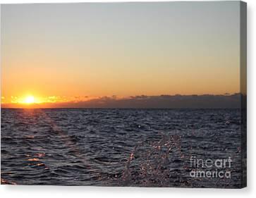 Sun Rising Through Clouds In Rough Waters Canvas Print by John Telfer