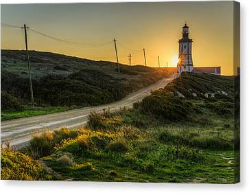 Sun Sets Behind The Lighthouse Canvas Print