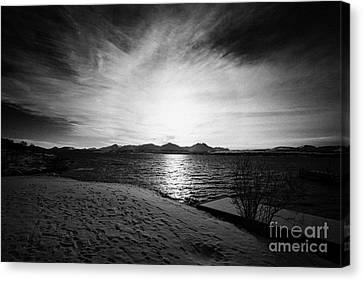 sun setting with halo over snow covered telegrafbukta beach Tromso troms Norway europe Canvas Print by Joe Fox