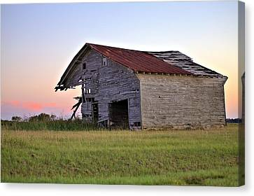 Sun Slowly Sets Canvas Print by Gordon Elwell
