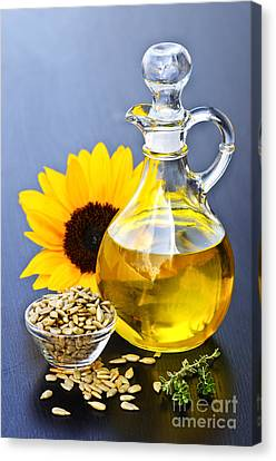 Sunflower Oil Bottle Canvas Print by Elena Elisseeva