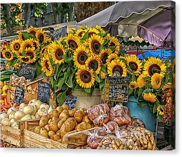 Sunflowers In A French Market Canvas Print by Sandra Anderson
