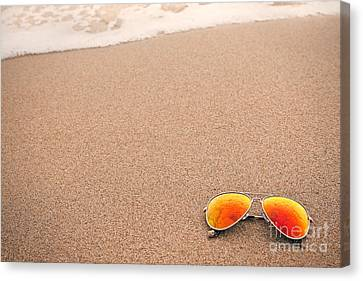 Sunglasses On The Beach Canvas Print by Sharon Dominick