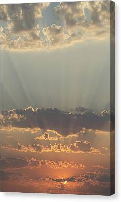Sunlight Shining Through Clouds And Canvas Print by Keith Levit