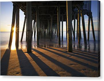 Sunlit Pilings Canvas Print by Eric Gendron