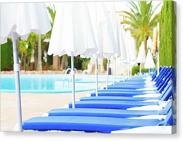 One Point Perspective Canvas Print - Sunloungers And Parasols In A Row by Wladimir Bulgar