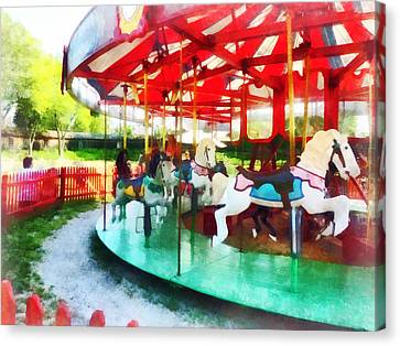 Sunny Afternoon On The Carousel Canvas Print by Susan Savad