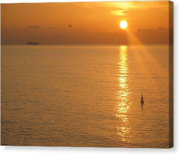 Canvas Print featuring the photograph Sunrise At Sea by Photographic Arts And Design Studio