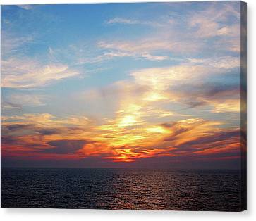 Sunrise At Sea Canvas Print by Susan Savad