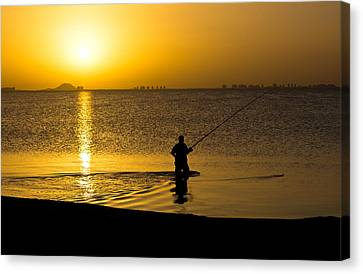 Sunrise Fishing Canvas Print by Scott Carruthers