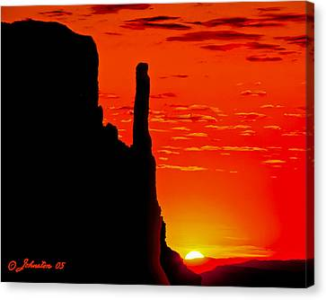 Sunrise In Monument Valley Canvas Print by Bob and Nadine Johnston