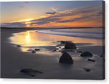 Sunrise On A Beach Near The Port Canvas Print by Irwin Barrett